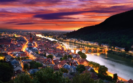 theodor: Heidelberg, Germany, aerial view at dusk, with dramatic sunset sky and the lights of the city, Neckar river and the Old Bridge