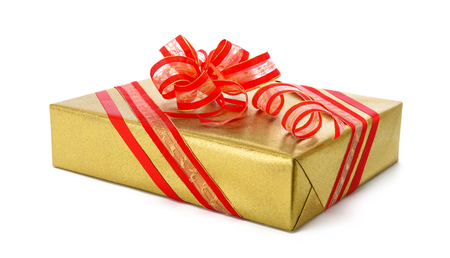spiffy: Gold gift box with red ribbon and a nice fancy bow, studio isolated on white background Stock Photo