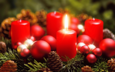one: Studio shot of a nice advent wreath with baubles and one burning red candle