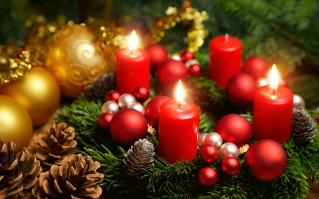 christmas candles: Studio shot of a nice advent wreath with baubles and three burning red candles Stock Photo