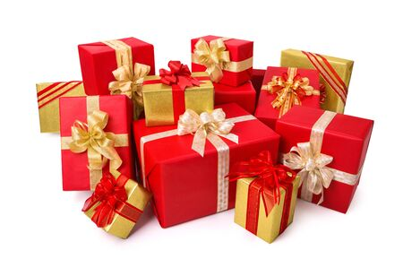 lot of: Fashionable pile of red and gold gift boxes with ornate bows, studio isolated on white background
