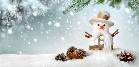 festive pine cones: Modern seasonal background in blue-green and white, with a cute happy snowman in the snow, ideal for Christmas or winter season