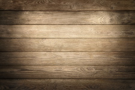 Elegant wood planks background nicely illuminated with spotlights to draw the attention