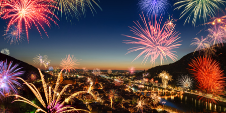 Festive fireworks display over the city, a panoramic aerial view of the scenic cityscape of Heidelberg, Germany, at dusk