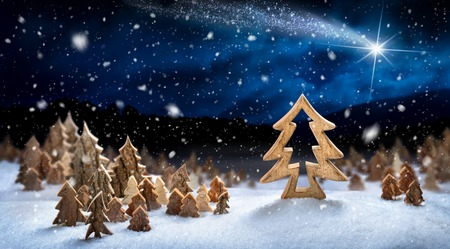 snow forest: Wooden decoration arranged in snow, forming a fantasy forest night landscape with a shooting star, ideal for Christmas or winter