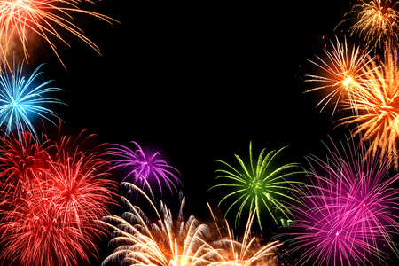 Gorgeous multi-colored fireworks as a border on black background, ideal for New Year or other celebration events