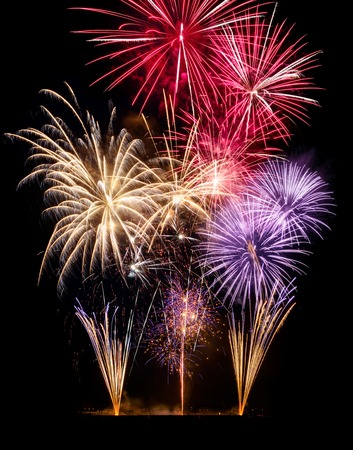 Gorgeous fireworks on black background, ideal for New Year or other celebration events, vertical format Stock Photo
