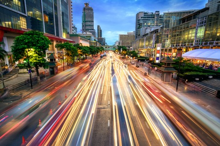 Busy street in the city at dusk, full of car light streaks; dynamic blue hour shot with long exposure motion blur effect 스톡 콘텐츠