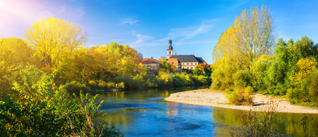 Panorama of an idyllic place at Neckar River, Germany, on a nice autumn day, with the small church of the residing town Reklamní fotografie