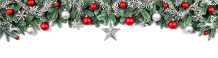 Wide arch-shaped Christmas border isolated on white, composed of fresh fir branches and ornaments in red and silver
