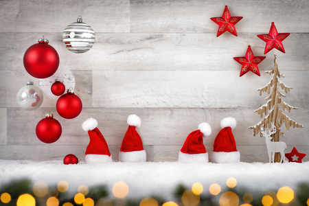 Christmas background in bright wood style, modern, simple and elegant, with a border of baubles, lights, stars, small Santa hats and snow Imagens