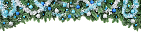 Studio isolated lush fir branches with baubles in blue and white, as a border or arch on pure white background Imagens