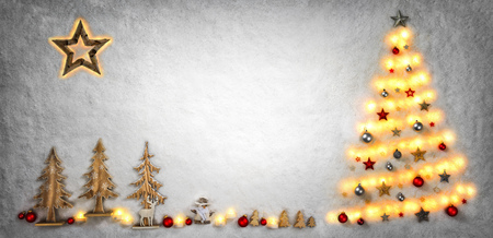 Christmas symbols creatively shaped with lights and wooden ornaments on snow background, with bright copy space Imagens