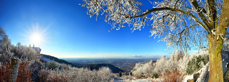 Snowy landscape with panoramic view on Heidelberg, Germany, on a glorious sunny winter day