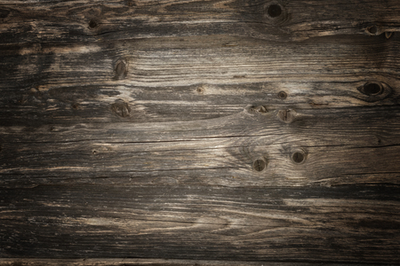 Rustic dark wooden planks background with vivid texture and vignette lighting Imagens