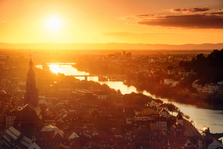 Heidelberg, Germany, romantic aerial view in gold light before sunset, with the old town and the Neckar river Imagens