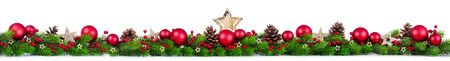 Extra wide Christmas border with fir branches, red and silver baubles, pine cones and other ornaments, isolated on white Stock fotó