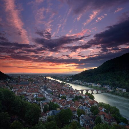 Beautiful aerial view of Heidelberg, Germany, at a tranquil yet dramatic sunset