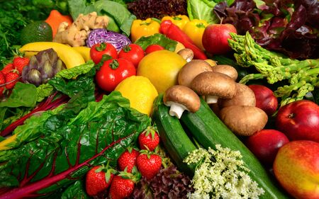Arrangement of fruits and vegetables in many appetizing colors, inviting to lead a healthy plant-based lifestyle and self-care