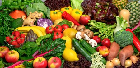 Arranged pile of fruits and vegetables in many appetizing colors, inviting to lead a healthy plant-based lifestyle and self-care