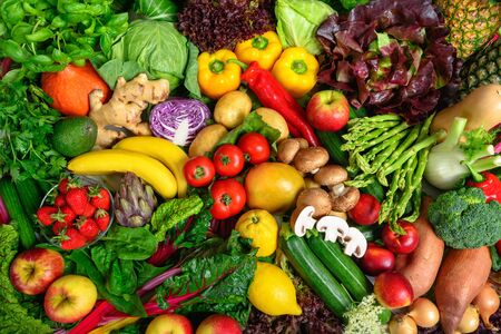 Pile of fruits and vegetables in many appetizing colors, shot from above, inviting to lead a healthy plant-based lifestyle and self-care