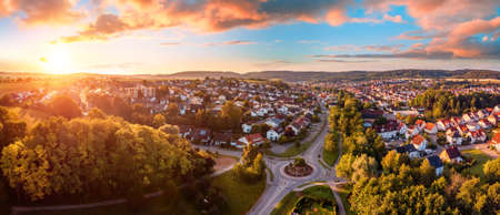 Aerial panorama of a European town at sunrise, with magnificent colorful sky and warm light