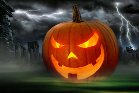 Glowing Jack o Lantern in a dark graveyard with lightning bolts in the night sky