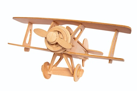 toy plane: Wooden airplane model isolated over white background