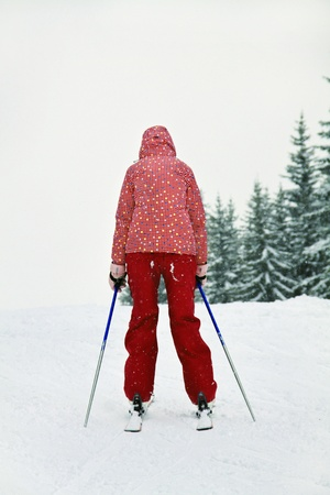 Skier in front of the slope Stock Photo