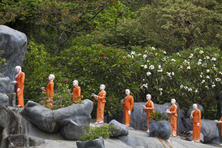 Statues of monks in Dambulla, Sri Lanka