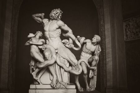 atilde: VATICAN CITY, VATICAN - OCTOBER 07, 2010  Laocoön and His Sons sculpture on October 7, 2010 in  Vatican Museums   The statue showingn the Trojan strangled by sea serpents is attributed by the Roman author Pliny the Elder