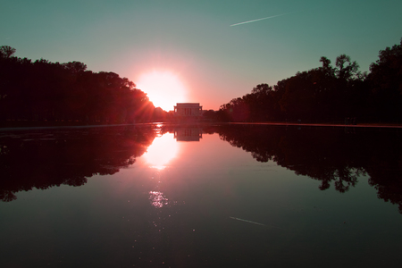 Lincoln Memorial in front of reflecting pool in the evening