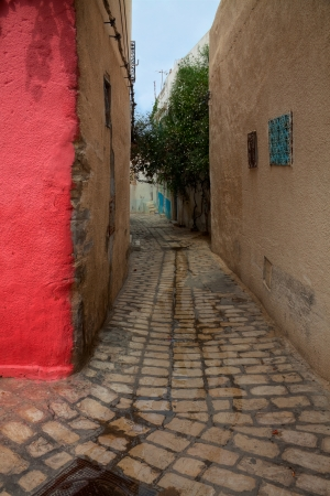 Narrow street in Sousse, Tunisia photo
