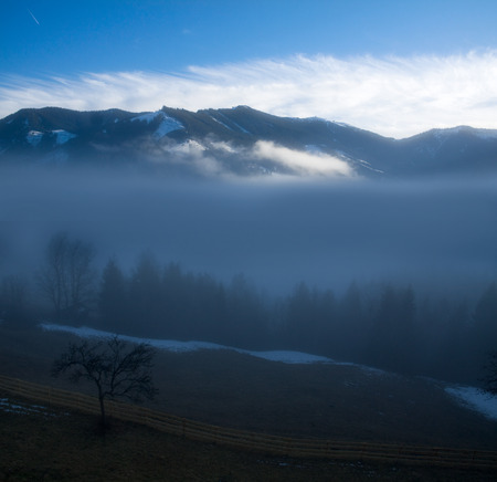 solstice: Foggy morning in the Alps