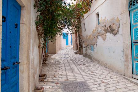 Poor street in Medina of Sousse, Tunisia photo
