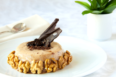 Prune jello decorated with walnuts and chocolate