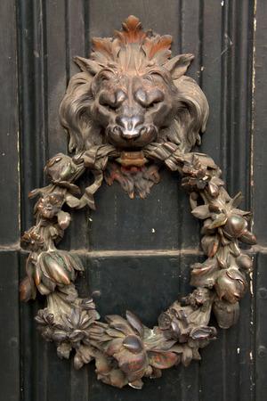 Antique door knocker - lion head shape