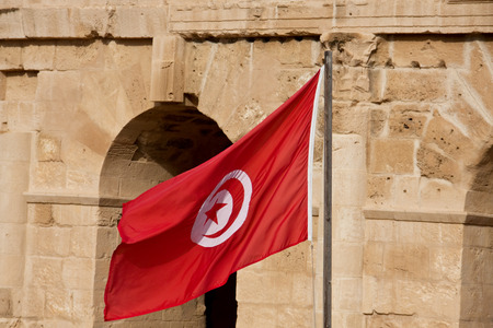 Flag of Tunisia in front of El Djem Colosseum