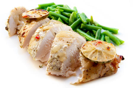 Cooked chiken breast with green beans isolated Stock Photo