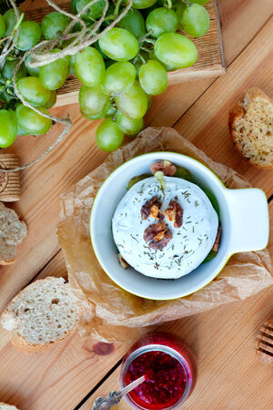 Baked Camembert cheese with raspberry sauce and grapes