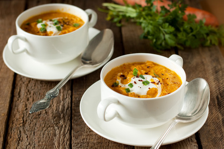 Two bowls of carrot soup puree Stock Photo
