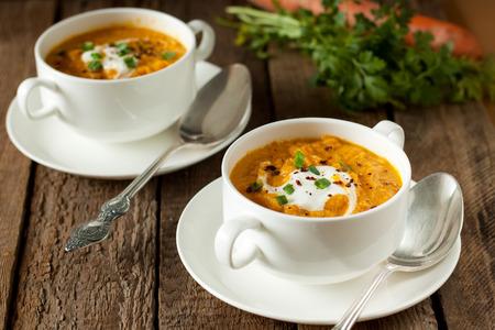 Two bowls of carrot soup puree Reklamní fotografie