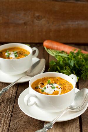 Bowl of carrot soup with yoghurt Reklamní fotografie