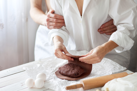 Couple cooking together in the morning Stock Photo
