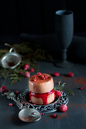 Chocolate panna cotta with raspberry sauce