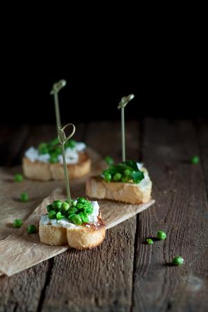 Green peas bruschetta with brynza cheese