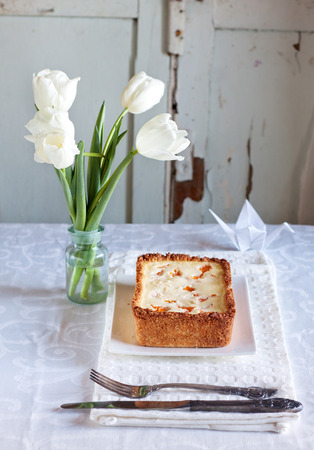 Cheese cake with apricots in a coconut crust Stock Photo