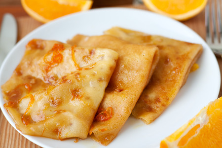 french cuisine: Crepe suzette pancakes - french cuisine breakfast