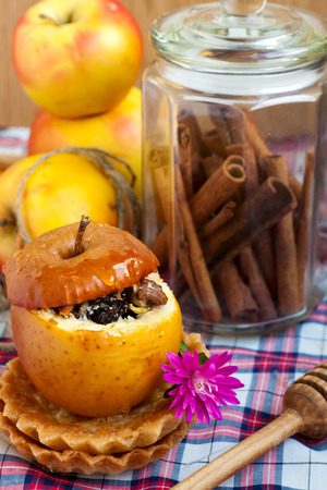 Baked apple with dried fruit and nuts Stock Photo