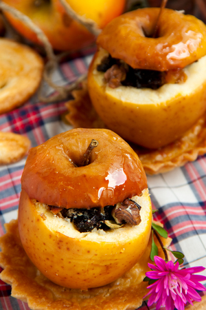 Helathy dessert - dried fruit stuffed baked apples Reklamní fotografie